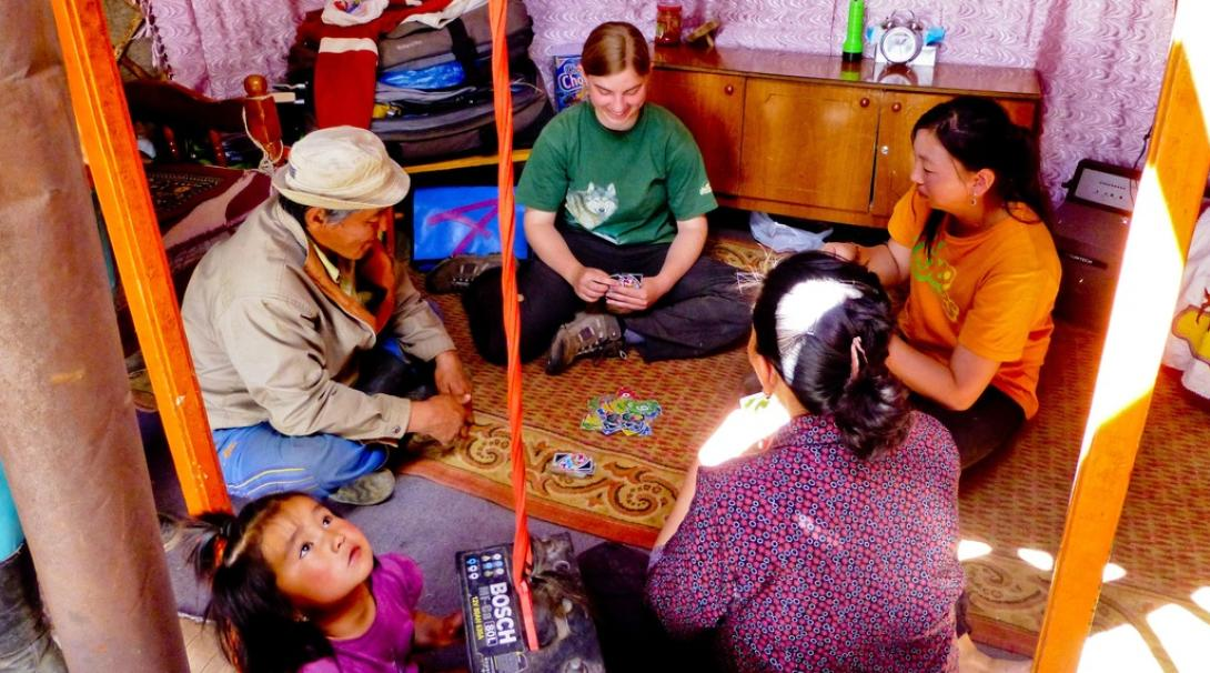 A Projects Abroad volunteer playing cards with her host family in Mongolia